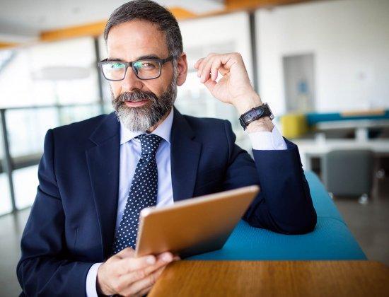 shot-of-thinking-financial-advisor-businessman-wor-AFYRT9E